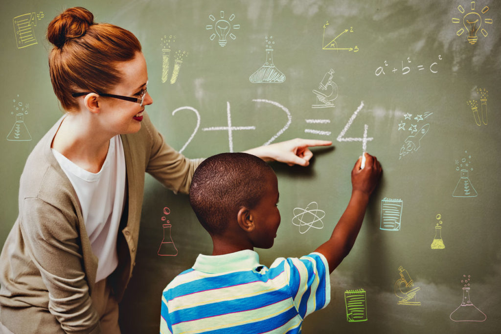 Women Tutoring maths in the blackboard