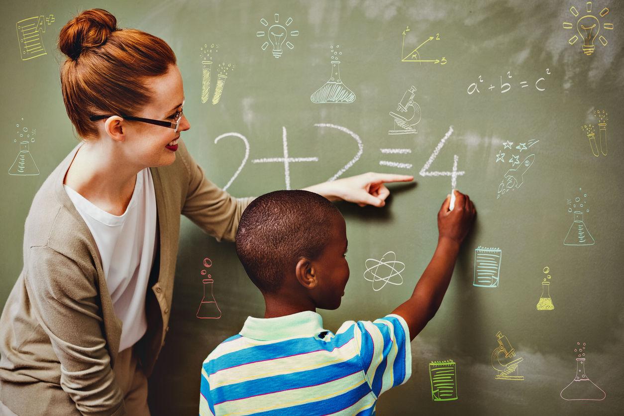 Women Tutoring maths in the blackboard